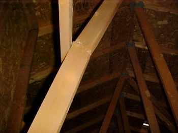 Broken attic truss web member may be easily repaired, but ONLY by a professional!