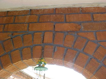 Settlement cracks, like the one in the top of this masonry arch, are an indication of structural movement.